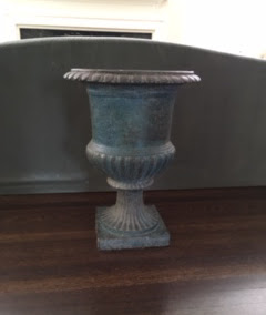 Pair of antique iron urns