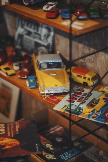 Yellow collectible car toy on shelf