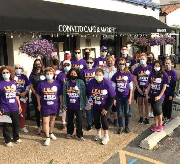 Team in front of cafe for Alzheimer's Walk